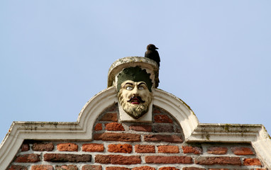 Culemborg, renaissance Gable with man's head and a crow on it