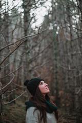 Cheerful woman posing in woods