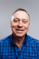 Portrait of a smiling elderly man