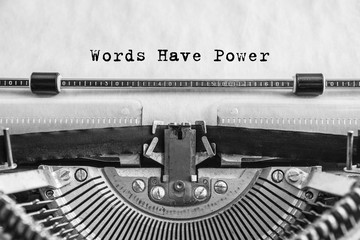 Words Have Power text typed words on a vintage typewriter. Close up