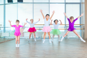 Children dancing in choreography class. happy children dancing on in hall, healthy life, kid's togethern dance kid class