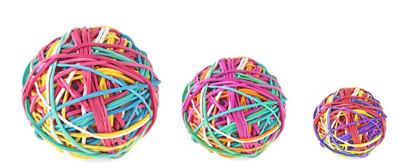 Three colorful balls of rubber bands on a white background