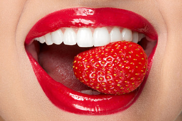 Lips. Woman With Red Lipstick And Strawberry