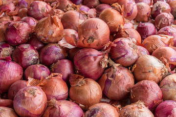 Red onions at a market place