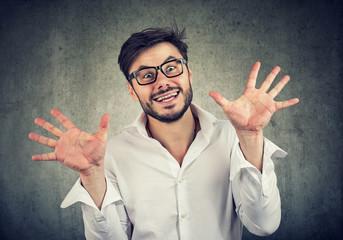 Crazy weird man posing with hands