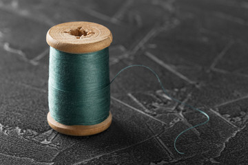 sewing thread on an old wooden spool