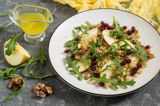 Vitamin vegetarian salad with quinoa, fruits and nuts