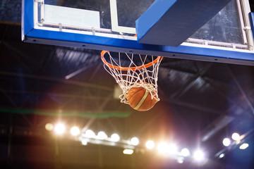 scoring during basketball game - ball going through hoop