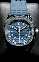 """Aquanaut Luce """"Misty Blue"""" watch of Swiss watch manufacturer Patek Philippe is displayed at the Baselworld watch and jewellery fair in Basel"""