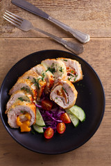 Chicken Cordon Bleu. Chicken breast wraps with ham and cheese, overhead, top view