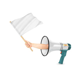 The concept of shopping. Sticking out of a pile of clothes a hand holds a white flag isolated on a white background. Help in choosing clothes.