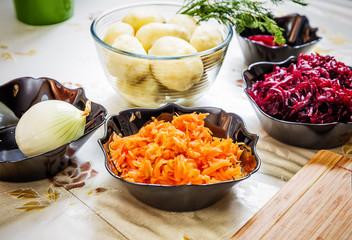 preparing russian traditional salad 'herring under fur coat'