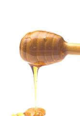 Honey with a Honey Spoon on a White Background