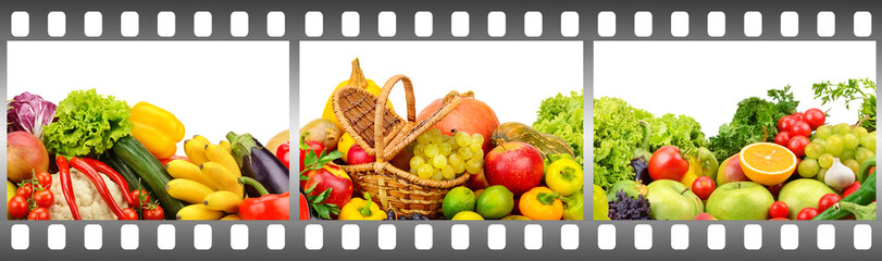 Ripe fruits and vegetables in frame made of photographic film