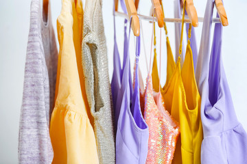 Different clothes on hangers, indoors