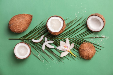 Composition with coconut water and fresh nuts on color background