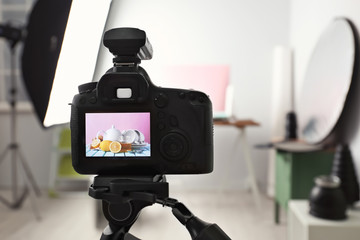 Professional camera on tripod in studio, closeup. Food photography