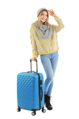Young woman with suitcase on white background. Ready for winter vacation