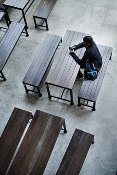 Teenage boy sitting alone in an empty canteen