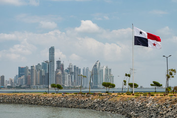 National flag of Panama with skyline of Panama City