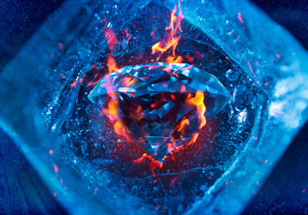 Photo of a burning diamond inside blue cold ice cube.