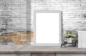 Mock up poster or photo frame  on wooden table with  row of books