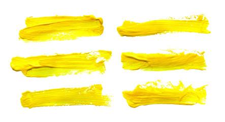 Set of yellow gouache brush strokes