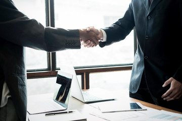 success business partners shaking hands after complete a deal in office, success deal and strategy concept
