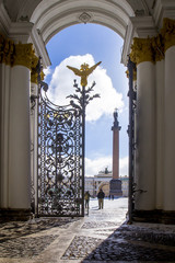 View of the Palace Square, Arch of the General Staff and the Alexandrian Column with an Angel through an open cast-iron gate, St. Petersburg, Russia