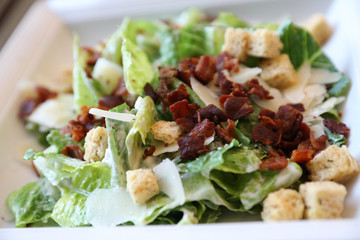Caesar salad , vegetable with bread bacon and cheese