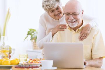 Senior marriage looking on laptop