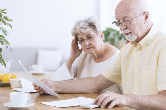 Sad elderly marriage with documents
