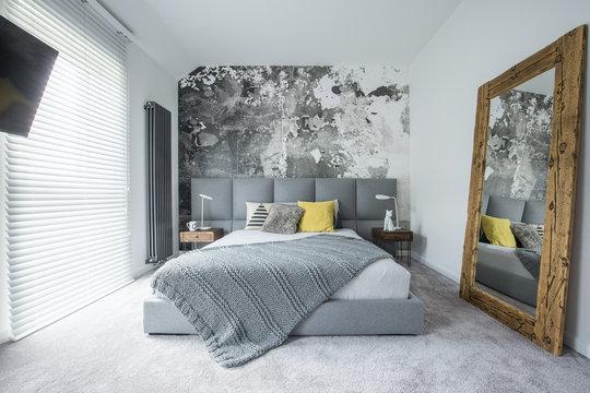Grey bedroom interior with mirror