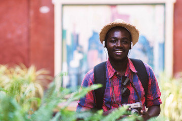 Tourist African man feel happy with travel place in scenery town.