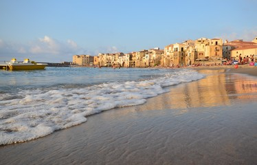 Cefalù, Italy, Sicily August 16 2015 Cefalù beach. It is possible to take a bath admiring the old town overlooking the sea, the fortress of Cefalù overlooking the sea, tourists from all over the world