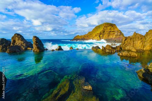 Wall mural Natural volcanic lagoon  pools at Porto Moniz, Madeira island, Portugal