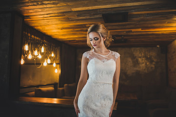 bride portrait in loft interiot closed eyes