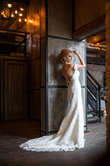 woman in wedding dress posing in luxury interior