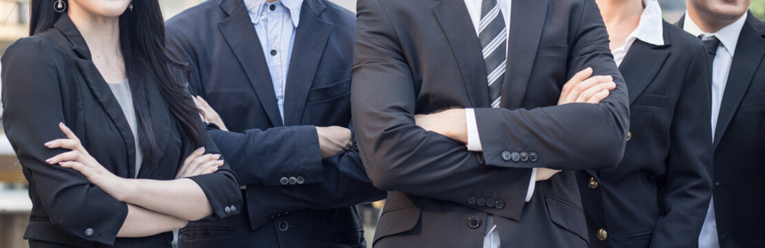 Horizontal of teamwork and confident of business team, businessman and  cross one's arm.
