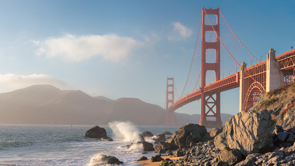 Golden Gate Bridge at sunset seen from the Marshall's Beach in San Francisco, California.