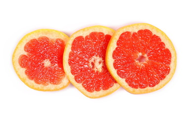 Grapefruit slices isolated on white background, top view