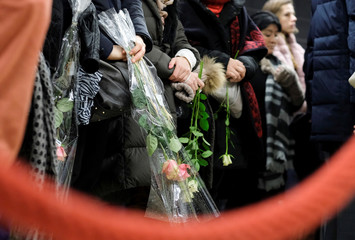 People attend a ceremony at the Maelbeek metro station to commemorate two years since bombings at Brussels airport and a metro station, in Brussels