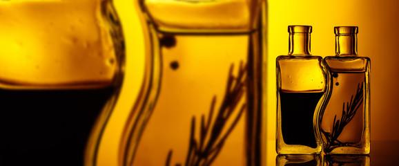 Bottles of flavored olive oil and balsamic vinegar .