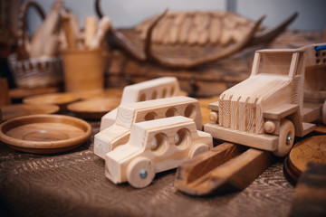 The cars is a toy made of natural wood