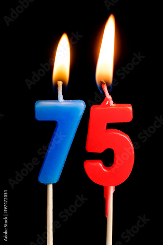 Burning Candles In The Form Of 75 Seventy Five Figures Numbers Dates For Cake Isolated On Black Background Concept Celebrating A Birthday