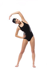 isolated swimmer woman with swimming glasses on white background doing her warm up