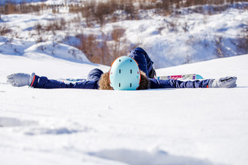 Photo of sporty woman with snowboard lying