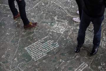 Messages are beamed onto a map at the #LondonUnited memorial at City Hall, marking the anniversaries of the four terror attacks in London in 2017 in London