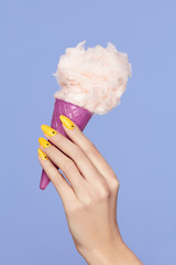 Nail Art. Hands With Colorful Nails And Cotton Sugar Ice Cream