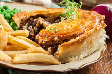 Homemade beef stew pie with french fries